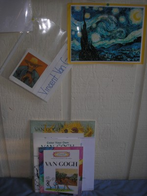 I slip the art cards into a sheet protector and then post them on our art wall.
