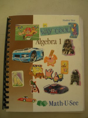 My son's well-loved Math-U-See Algebra Text. (Yes we still do stickers.)
