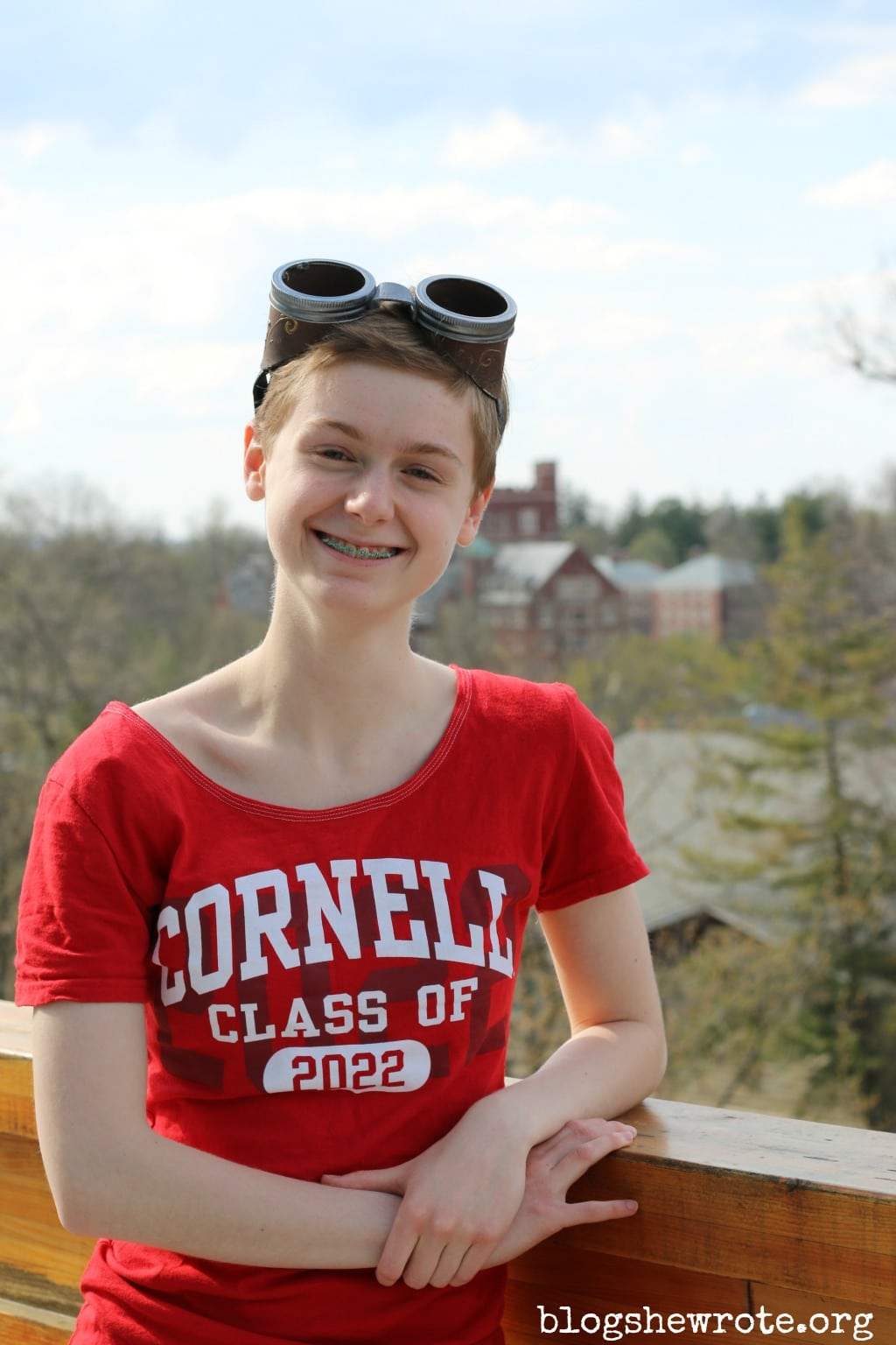 Homeschooling for College by Design at BlogSheWrote.org Newly accepted freshman at Cornell wearing a tshirt class of 2022